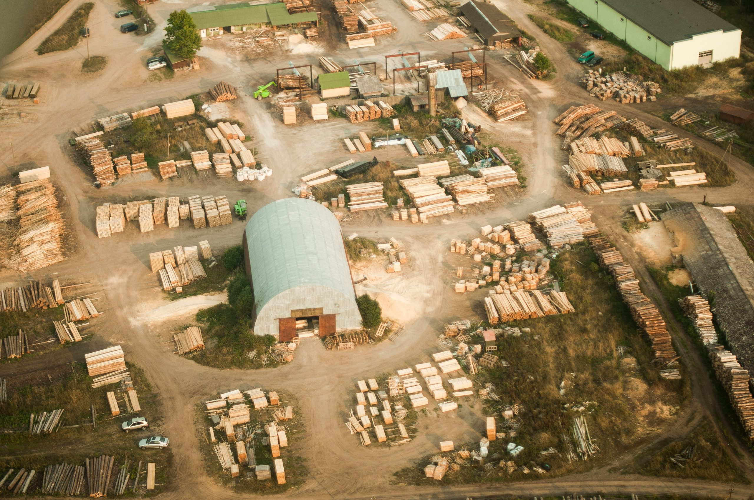 Sustainable design step 3, aerial view of planks in a timber yard