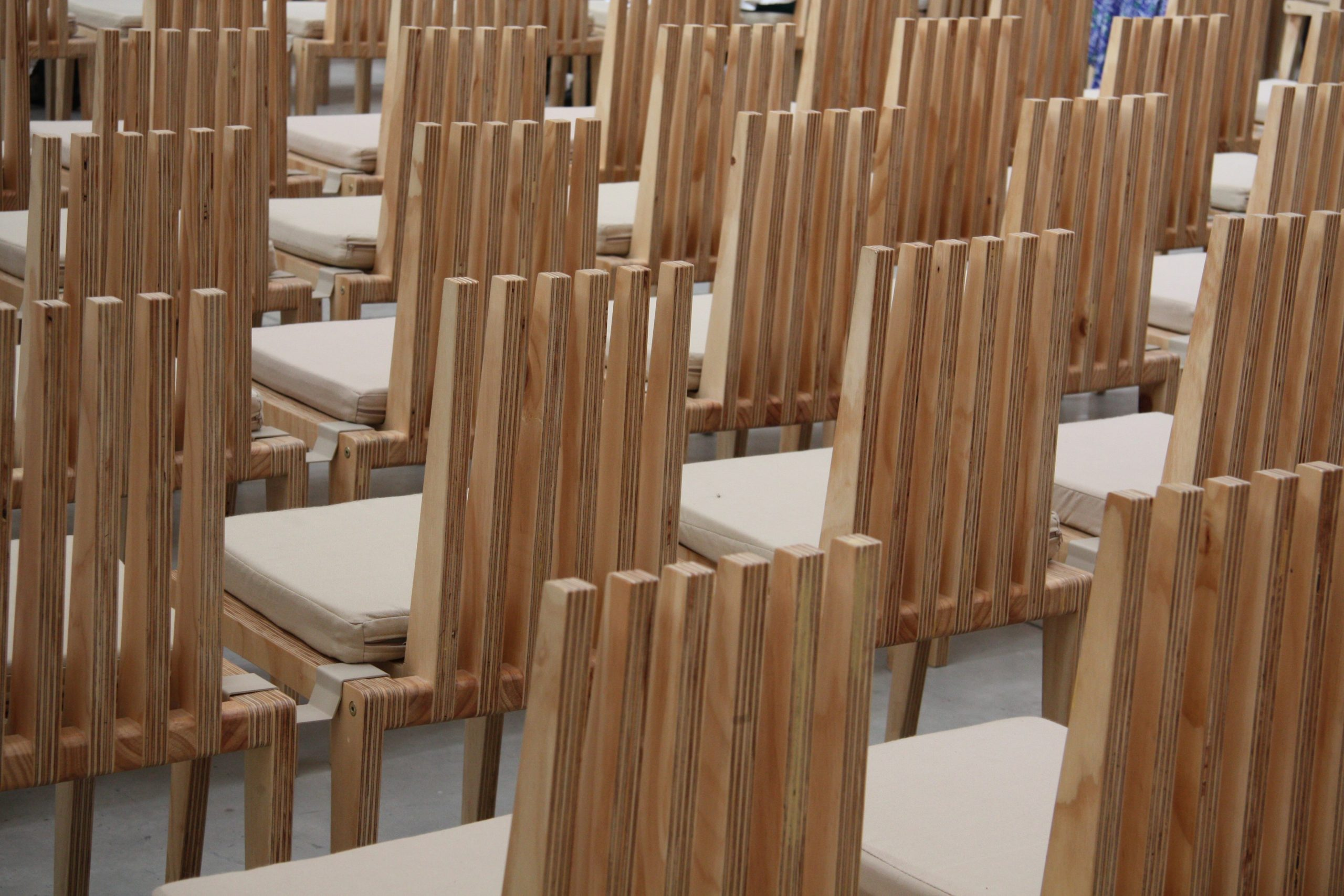 Sustainable design step 5, plywood chairs arranged in rows
