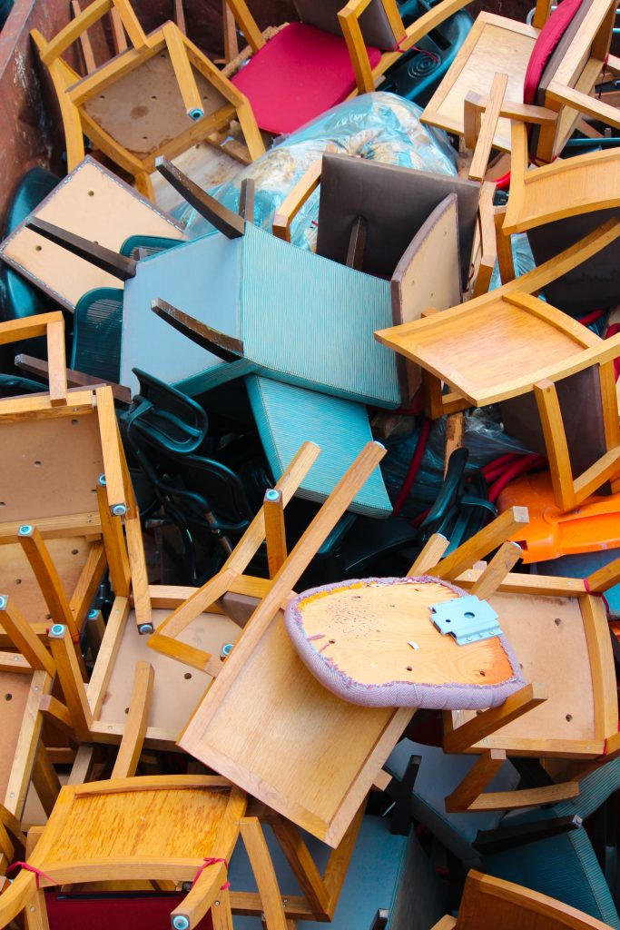 pile of wooden chairs